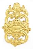 De um ornamento antigo do ouro em um fundo branco Fotografia de Stock
