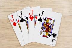 4 de una clase levanta - el casino que juega tarjetas del póker imagenes de archivo