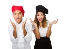 De unbelieving gezichten van het chef-kokteam stock fotografie