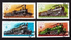 DE USSR - CIRCA 1979: een reeks zegels die in de USSR worden gedrukt, toont treinen, CIRCA 1979 Stock Afbeeldingen