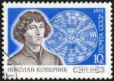 De USSR - 1973: toont Nicolaus Copernicus (1473-1543) en Zonnestelsel, Poolse astronoom, 500ste geboorteverjaardag van Copernicus Stock Foto's