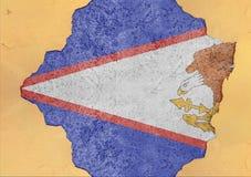 De V.S. verklaren de Amerikaanse vlag van Samoa in groot concreet gebarsten gat royalty-vrije stock afbeelding