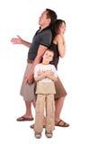 De vader, de zoon en de moeder zijn verrast, bang en B stock fotografie