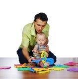 De vader en zijn zoon Stock Foto's