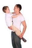 De vader houdt zoon van aangezicht tot aangezicht Royalty-vrije Stock Afbeelding