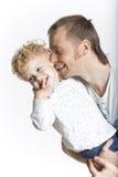 De vader kust affectionately zijn zoon stock afbeelding