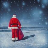 De vakantie is over, neemt de Kerstman een vakantie Stock Afbeeldingen