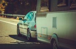 De Vakantiereis van de reisaanhangwagen stock foto