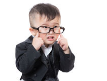 De van bedrijfs Azië baby raakt zijn oog royalty-vrije stock fotografie
