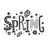 De van letters voorziende Lente met decoratieve bloemenelementen Stock Foto's