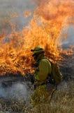 De vechter en de vlammen van de brand royalty-vrije stock foto