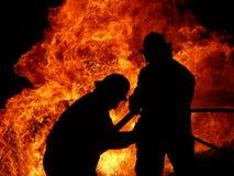 De vechter van de brand silhouetteert 3 Royalty-vrije Stock Fotografie