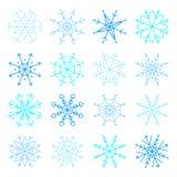 De vector blauwe reeks van het sneeuwvlokpictogram De pictogrammen van inzamelingssneeuwvlokken Royalty-vrije Stock Afbeelding
