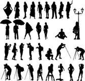 De vector silhouetteert de vrouw op vakantie en mannen fotograaf Royalty-vrije Stock Afbeelding