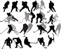De vector Spelers van het Hockey - Silhouetten. Royalty-vrije Stock Afbeeldingen