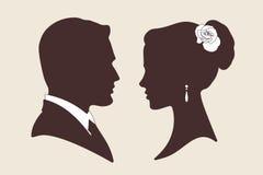 De vectorsilhouetten van het huwelijksontwerp van bruidegom en bruid Royalty-vrije Stock Foto
