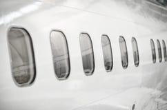 De vensters van passagiersvliegtuigen Stock Afbeeldingen
