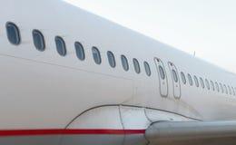 De vensters van passagiersvliegtuigen Stock Foto