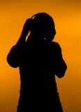 De ventilator van de muziek. Silhouet van de mens met oortelefoons stock foto's