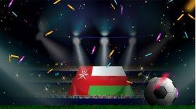 De ventilators houden de vlag van Oman onder silhouet van menigtepubliek in voetbalstadion met confettien om voetbalspel te viere royalty-vrije stock foto