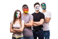 De ventilators van groeps mensen verdedigers van nationale teams met geschilderd vlaggezicht van Duitsland, Mexico, de Republiek  stock foto's