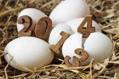 de verandering van 2013 tot 2014, eierenconcept Royalty-vrije Stock Foto's