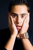 De verbaasde mens met overhandigt gezicht Royalty-vrije Stock Fotografie