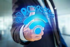 de verbinding van het wifisymbool door multimedia en Internet dat app wordt omringd Royalty-vrije Stock Foto's