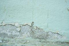 De verf op de muur, het pellen de textuur van de kleurenkleur, verslechtering van de verf op de oude muur, muur loopt over stock fotografie