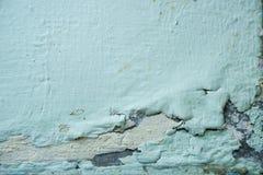 De verf op de muur, het pellen de textuur van de kleurenkleur, verslechtering van de verf op de oude muur, muur loopt over royalty-vrije stock afbeelding