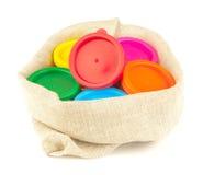 De verf van de kleur in vlaszak stock afbeeldingen