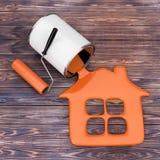 De verfrol dichtbij het Oranje Verf Gieten van Verf kan binnenshuis S stock illustratie
