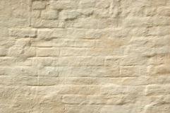 De vergoelijkte bakstenen muur Stock Afbeeldingen