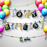 De verjaardagskaart met Wasknijper en de kleurrijke brieven hangen op kabel Stock Foto