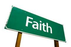 De verkeersteken van het geloof die op wit worden geïsoleerdr. stock foto's