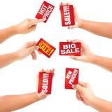 De verkoop van het de holdingsadreskaartje van de hand met kortingen. Royalty-vrije Stock Afbeelding