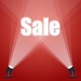 De VERKOOP van Word schijnwerperverlichting schijnwerper rode achtergrond Royalty-vrije Stock Afbeelding