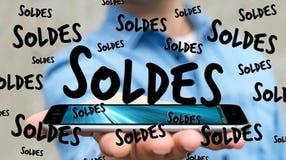De verkooppictogrammen van de zakenmanholding over zijn telefoon het 3D teruggeven Stock Fotografie