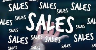 De verkooppictogrammen van de zakenmanholding in zijn hand het 3D teruggeven Royalty-vrije Stock Foto's