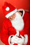 De vermoeide Kerstman royalty-vrije stock afbeeldingen
