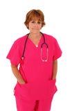 De verpleegster die zich met Roze bevindt schrobt Stock Afbeelding