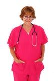 De verpleegster in Roze schrobt Status met Glazen Royalty-vrije Stock Foto