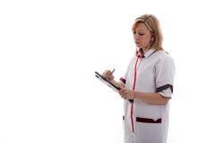 De verpleegster schrijft nota's Royalty-vrije Stock Foto