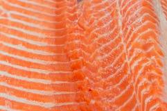 De verse roze de textuurachtergrond van het zalmvlees, sluit omhoog beeld van s royalty-vrije stock afbeeldingen