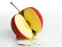 De verse Vruchten van de Appel met de plons van het Water Stock Afbeeldingen