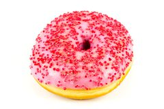 De verse zoete roze doughnut met rood bestrooit stock foto's