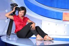 De verslaggever van TV in studio Stock Foto