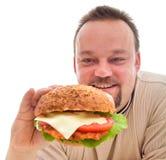 De verslaving van het voedsel - mens in ontkenningsfase Stock Afbeelding