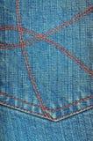De versleten blauwe textuur van denimjeans Stock Fotografie