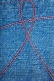 De versleten blauwe textuur van denimjeans Stock Foto's
